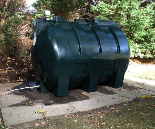Dark Green Plastic Tank Installation On Concrete