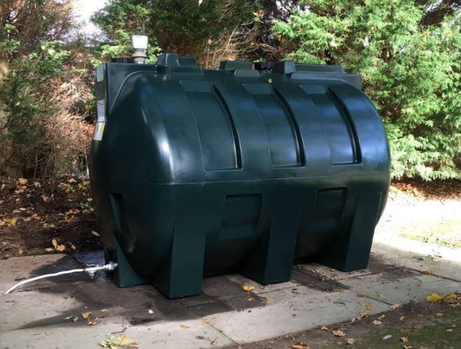 Green Plastic Tank Installation On Concrete