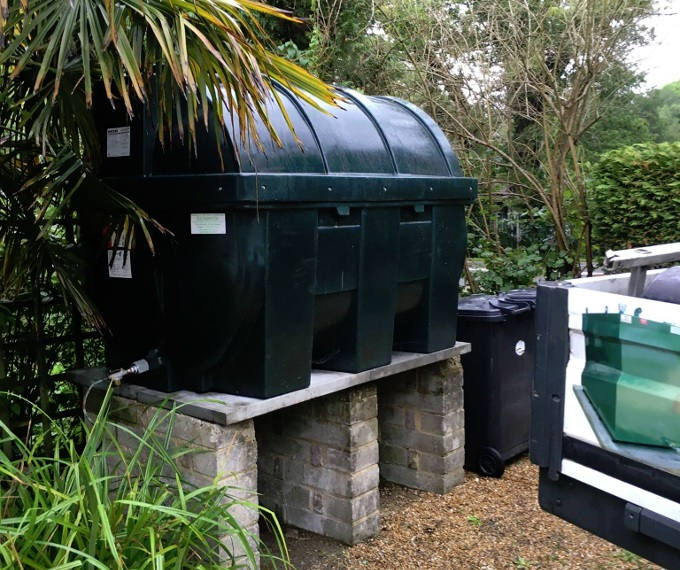 Bunded oil tank positioned outdoors
